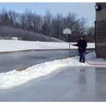 man flooding skating rink