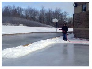 man flooding skating rink